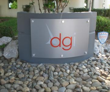 Brushed aluminum panel custom curved for monument with sign vinyl decoration and aluminum standoffs for mounting to concrete.